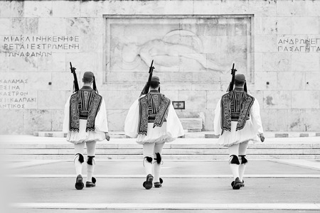 Honor Evzones guard in front of  the Tomb of the Unknown Soldier at the Parliament Building in Syntagma Square, Athens, Greece.