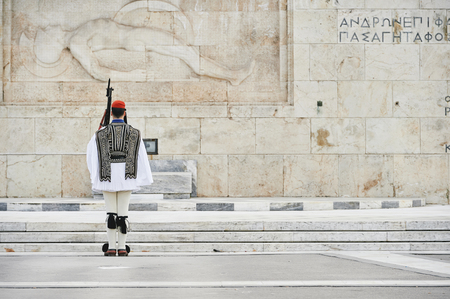 tomb unknown soldier: Honor Evzones guard in front of  the Tomb of the Unknown Soldier at the Parliament Building in Syntagma Square, Athens, Greece.