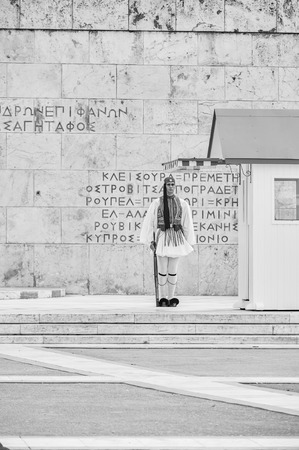 tomb of the unknown soldier: Athens, Greece - March 27, 2016: Still honor Evzones guards ceremony in front of  the Tomb of the Unknown Soldier at the Parliament Building in Syntagma Square, Athens, Greece. Editorial