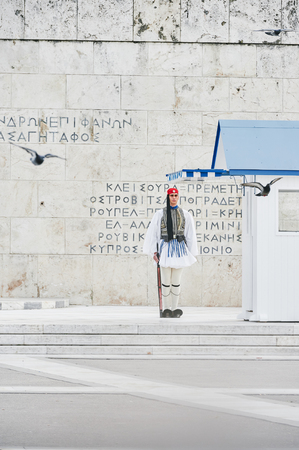 tomb unknown soldier: Athens, Greece - March 27, 2016: Still honor Evzones guards ceremony in front of  the Tomb of the Unknown Soldier at the Parliament Building in Syntagma Square, Athens, Greece. Editorial
