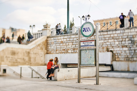artefacts: Syntagma Square and Metro entrance in Athens, Greece, Europe with pedestrians commuting and toursit entering to visit the archaeological artefacts found in the excavation for the station
