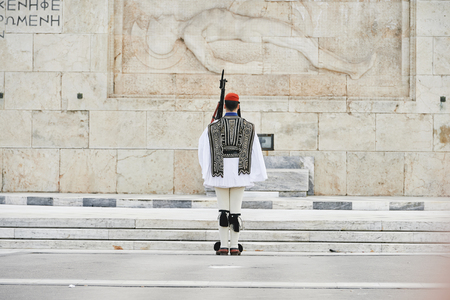 syntagma: Honor Evzones guard in front of  the Tomb of the Unknown Soldier at the Parliament Building in Syntagma Square, Athens, Greece.