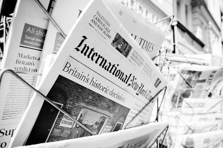 separatism: STRASBOURG, FRANCE - JUN 24, 2016: International New York Times and other major newspapers headline titles at press kiosk about the Brexit referendum in United Kingdom which has decidedthe country wishes to quit the European Union Editorial