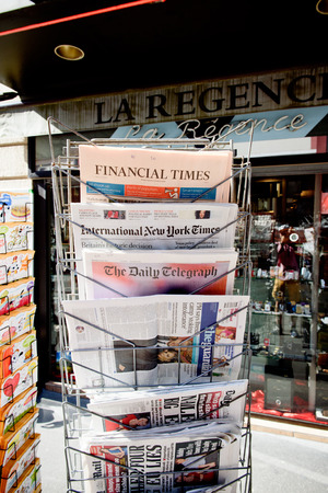 new york times: STRASBOURG, FRANCE - JUN 24, 2016: International New York Times, Financial Times, The Daily Telegraph, The Guardian and other major newspapers headline titles at press kiosk about the Brexit referendum in United Kingdom which has decidedthe country wishes