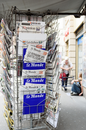 separatism: STRASBOURG, FRANCE - JUN 25, 2016: Le Monde french magazine with shocking headline titles that UK leaves EU at press kiosk about the Brexit referendum in United Kingdom requesting to quit the European Union Editorial