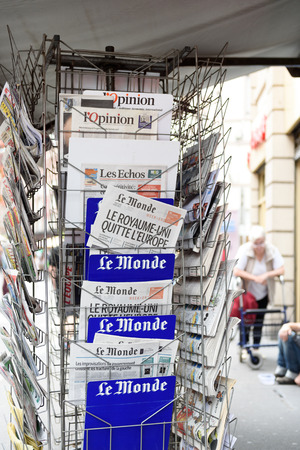 skepticism: STRASBOURG, FRANCE - JUN 25, 2016: Le Monde french magazine with shocking headline titles that UK leaves EU at press kiosk about the Brexit referendum in United Kingdom requesting to quit the European Union Editorial