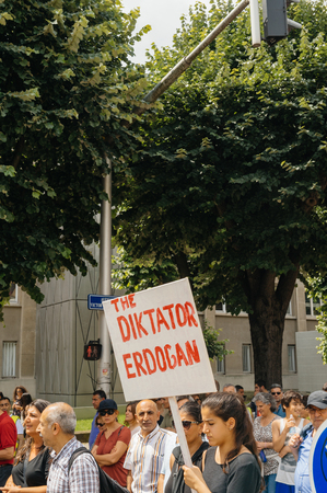 dictator: STRASBOURG, FRANCE - JUN 25: Members of Turkeys Alevi community protesting denouncing the evolution of the political situation in Turkey - Erdogan is a dictator Editorial
