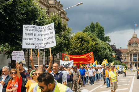 closed community: STRASBOURG, FRANCE - JUN 25: Members of Turkeys Alevi community protesting denouncing the evolution of the political situation in Turkey - closed boulevard with people holding placards