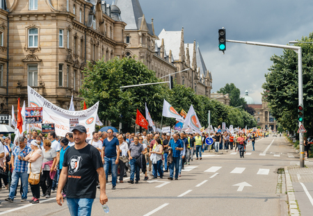 protesters: STRASBOURG, FRANCE - JUN 25: Members of Turkeys Alevi community protesting denouncing the evolution of the political situation in Turkey - protesters blocking street Editorial