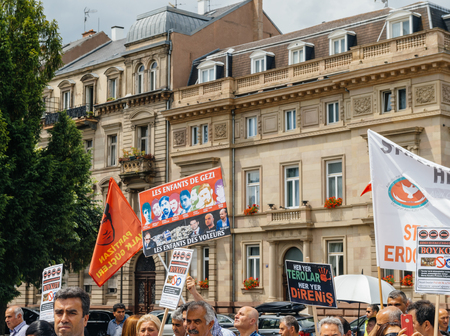 political and social issues: STRASBOURG, FRANCE - JUN 25: Members of Turkeys Alevi community protesting denouncing the evolution of the political situation in Turkey - placards against childrens of political figures