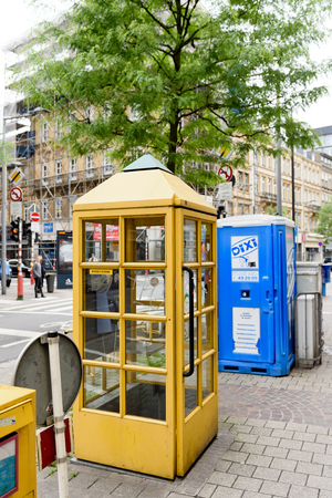 postes: LUXEMBOURG, LUXEMBOURG - Post Luxembourg yellow phone booth in the center of Luxembourg. Former Entreprise des Postes et Telecommunications, branded as POST Luxembourg and abbreviated to POST, is a mail and telecommunications semi government-owned corpora Editorial