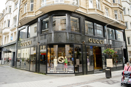 LUXEMBOURG, LUXEMBOURG - JUN 05, 2016: People admiring and buying goods inside luxury fashion GUCCI store in central Luxembourg on 16 Rue Philippe II