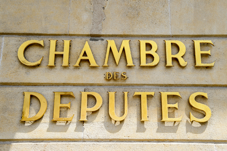 gobierno corporativo: Chamber of Deputies signage (Luxembourgish: DChamber, French: Chambre des Deputes, German: Abgeordnetenkammer), abbreviated to the Chamber the unicameral national legislature of Luxembourg. Krautmaart Foto de archivo