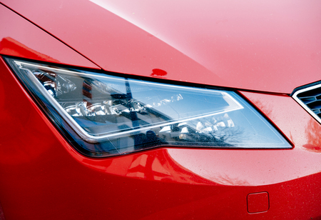 headlight: modern LED headlight of a red sport car