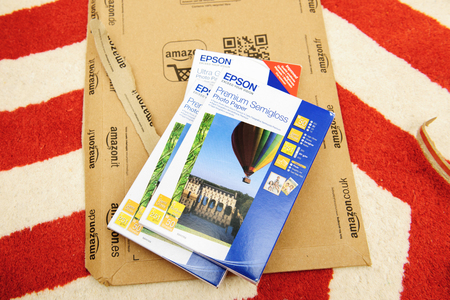 amazon com: PARIS, FRANCE - SEP 4, 2015: Stack of diverse Epson Premium Semigloss Paper and Ultra Glossy paper on Amazon box - right after unboxing