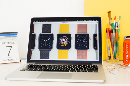 minnie mouse: PARIS, FRANCE - SEP 8, 2016: Apple Computers website on MacBook Pro Retina in a geek creative room environment showcasing new Apple Watch Series 2 multiple clock faces