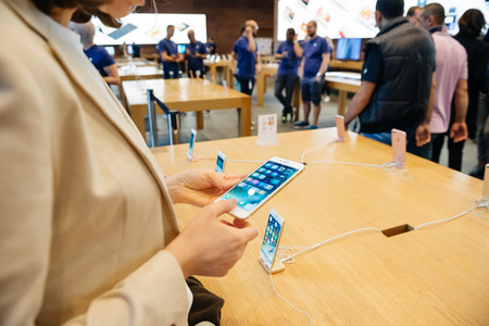 gamut: PARIS, FRANCE - SEPTEMBER 16, 2016: New Apple iPhone 7 Plus being tested by woman after purchase - looking at the new 3D Touch, wide gamut display. New Apple iPhone tends to become one of the most popular smart phones in the world in 2016