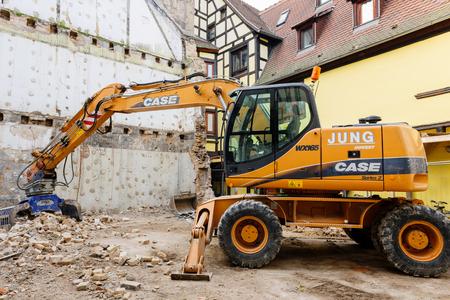 new construction: STRASBOURG, FRANCe - CIRCA 2015: Standard rock mass excavator with bucket mining showel steel teethes of a new Case caterpillar industrial excavator Editorial