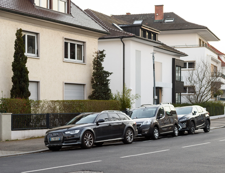 supercharged: STRASBOURG, FRANCE - MAR 18, 2016: AUDI wagon, Peugeot Car and Lexus Luxury SUV parked in front of luxury houses on calm city street neighborhood
