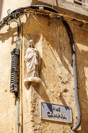 jesus statue: Rue Campra, Campra street with Jesus statue on the corner as seen on the streets of Aix-En-Provence, France Stock Photo