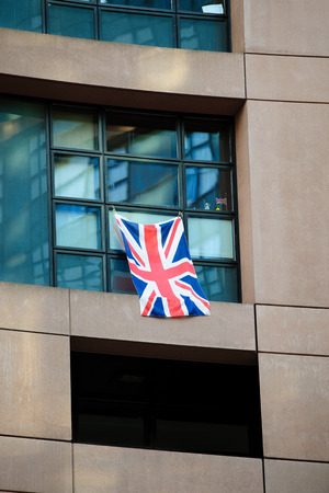parliamentarian: United Kingdom of Great Britain and Northern Ireland or Union Jack flag attached to a parliamentarian window at the European Parliament