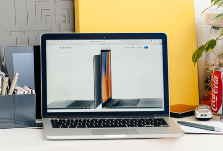15 inch: PARIS, FRANCE - OCT 28 2016: Apple Computers website on new MacBook Pro Retina with OLED touch bar in a geek creative room showcasing new professional laptop - detail of 13 inch laptop and 15 inch laptop next to eachother Editorial