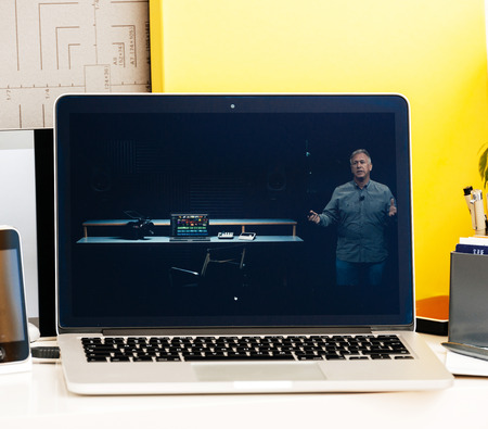 15 inch: PARIS, FRANCE - OCT 28 2016: Apple Computers website on new MacBook Pro Retina with OLED Touch bar in geek creative room showcasing Apple Keynote presentation of laptop performance, CPU GPU and Thunderbolt 3 ports