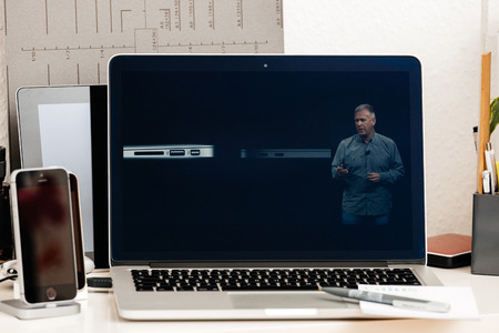 retina: PARIS, FRANCE - OCT 28 2016: Apple Computers website on new MacBook Pro Retina with OLED Touch bar in geek creative room showcasing Apple Keynote presentation of Thunderbolt 3 with USB 3