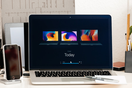 retina: PARIS, FRANCE - OCT 28 2016: Apple Computers website on new MacBook Pro Retina with OLED Touch bar in geek creative room showcasing Apple Keynote Comparing, Shipping, Price, Specs of laptops