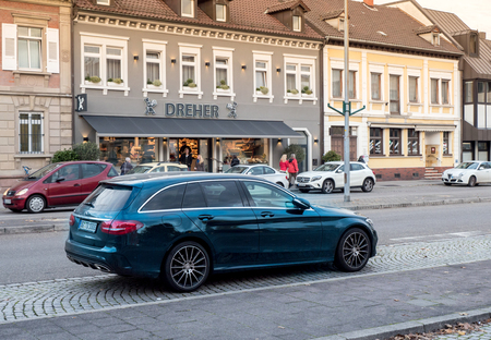 daimler: KEHL, GERMANY - NOV 4, 2016: Mercedes-Benz estate wagon car parked in center of typical German city. Mercedes-Benz is a global automobile manufacturer and a division of the German company Daimler AG. Mercedes-Benz E-Class, Mercedes-Benz CLS-Class