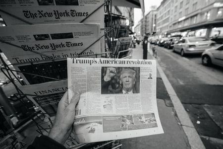 insecurity: PARIS, FRANCE - NOV 10, 2016: Man buying newspaper with shocking headline Trumps American Revolution title at press kiosk about the US President Elections - Donald Trump is the 45th President of United States of America