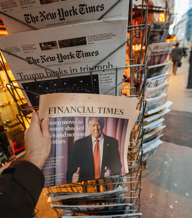 donald: PARIS, FRANCE - NOV 10, 2016: Man buying Financial Times newspaper with shocking headline title at press kiosk about the US President Elections - Donald Trump is the 45th President of United States of America
