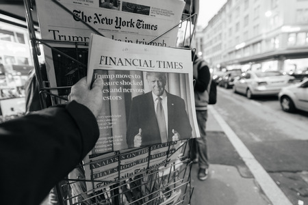 skepticism: PARIS, FRANCE - NOV 10, 2016: Man buying Financial Times newspaper with shocking headline title at press kiosk about the US President Elections - Donald Trump is the 45th President of United States of America