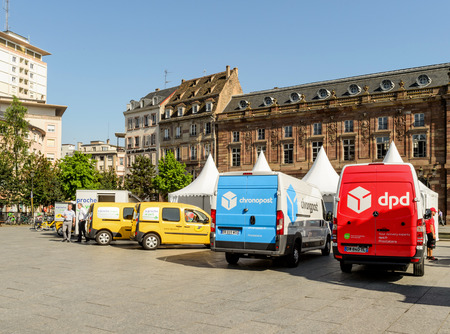 STRASBOURG, FRANCE - CIRCA 2016: CHRONOPOST, DPD and La Poste delivery vans in center of the city. Chronopost and DPD is part of French group La poste