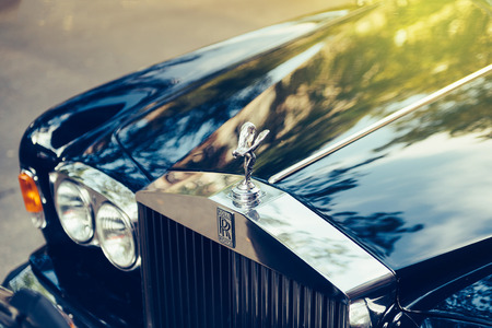 PARIS, FRANCE - SEP 12, 2016: Exclusive Luxury Rolls-Royce car limousine parked in city during fashion wedding vip event waiting for passenger. Rolls-Royce Limited is a British car-manufacturing and, later, aero-engine manufacturing company founded by Cha