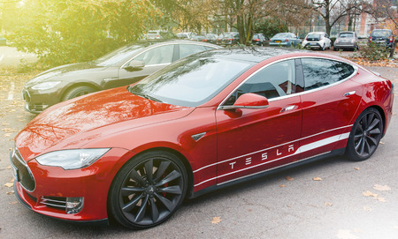 PARIS, FRANCE - NOVEMBER 29, 2014: Row of New Tesla Model S cars in front of showroom in Paris, France. Tesla is an American company that designs, manufactures, and sells electric cars