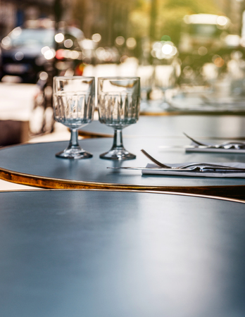 romatic: Eating in Paris - Breakfast lunch or dinner in a Parisian street restaurant cafe - round table is set in the most romatic city - Paris, France