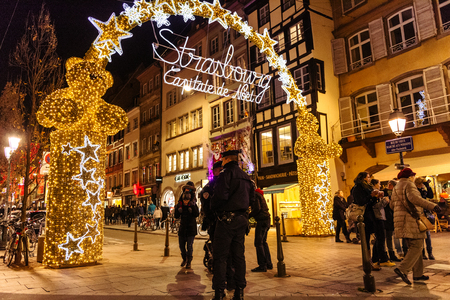 stock photo strasbourg france nov 28 2015 police officers surveilling the entrance gate with neon christmas decorations of the christmas market in - Police Officer Christmas Decorations