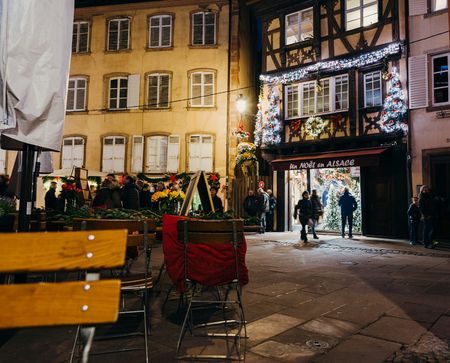 christkindlesmarkt: STRASBOURG, FRANCE - CIRCA 2016: Un noel en Alsace -  a Christmas in Alsace traditional Christmas Store decorated with toys, illuminations Editorial