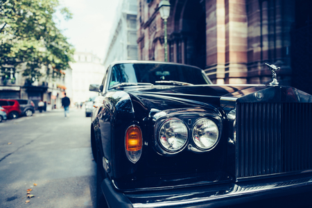 aeroengine: PARIS, FRANCE - SEP 12, 2016: Front view of Exclusive Luxury Rolls-Royce car limousine parked in city during fashion wedding vip event waiting for passenger. Rolls-Royce Limited is a British car-manufacturing and, later, aero-engine manufacturing company
