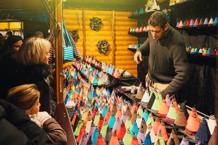 christkindlesmarkt: STRASBOURG, FRANCE - NOV 28, 2015: Traditional Christmas Market in Strasbourg Alsace France with people buying textile souvenirs