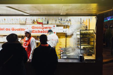christkindlesmarkt: STRASBOURG, FRANCE - NOV 28, 2015: Traditional Luxembourg potatoes food at the Christmas Market