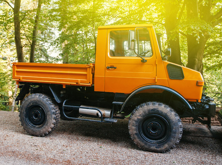 ag: FRANCE - MAY 10, 2015: Powerful Unimog four wheel drive vehicle as seen on a forest road. Unimog is a range of multi-purpose auto four-wheel drive medium trucks produced by Mercedes-Benz, a division of Daimler AG.