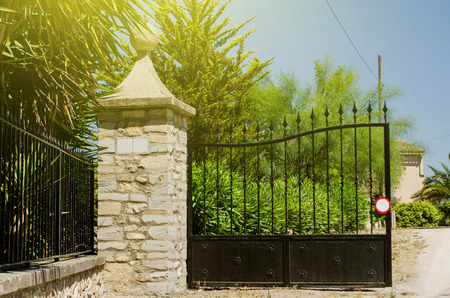 Entrance gate to a spanish hacienda on a bright sunny day with sun flare