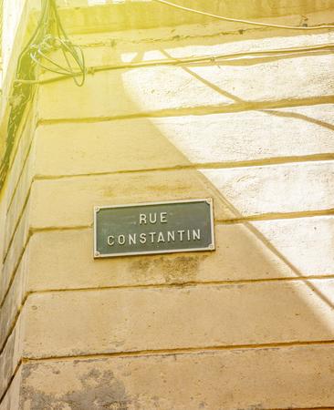 rue: Sunny day over Rue Constantion or Constantin street sign seen in Aix-en-Provence France