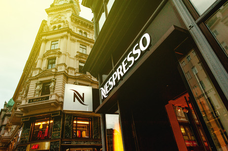 VIENNA, AUSTRIA - JULY 47, 2011: View of Nespresso logo on the frontage of the Nespresso store at the Graben shopping street in Vienna, Austria. Nespresso is the brand name of Nestlé Nespresso S.A., an operating unit of the Nestlé Group, based in La