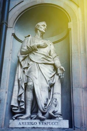 western european ethnicity: Statue of Amerigo Vespucci the famous Italian explorer, financier, navigator and cartographer in Uffizi Gallery, Florence, Italy with sun flare Stock Photo
