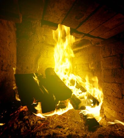 log fire: Homely warm log fire on a cold winter day  Stock Photo