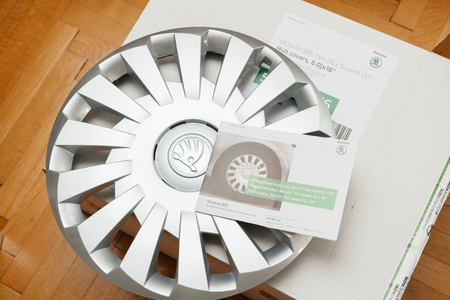 PARIS, FRANCE - DEC 7, 2016: Unpacking modern hub covers for the winter tyres made by Skoda Auto for Skoda Superb, Skoda OCtavia and Skoda Roomster  - online internet shopping