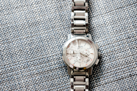 zenith: PARIS, FRANCE - NOV 26, 2016: Zenith male watch with broken destroyed sapphire glass waiting to be repaired